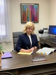 H writing at desk 020419